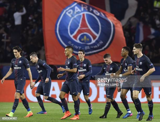 Paris SaintGermain's players celebrate after Paris SaintGermain's German midfielder Julian Draxler scored a goal during the UEFA Champions League...