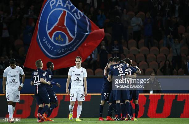 Paris SaintGermain's players celebrate after scoring a goal during the French L1 football match between Paris SaintGermain and Metz at the Parc des...