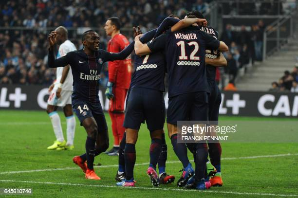 Paris SaintGermain's players celebrate after scoring a goal during the French L1 football match Olympique de Marseille vs Paris SaintGermain on...