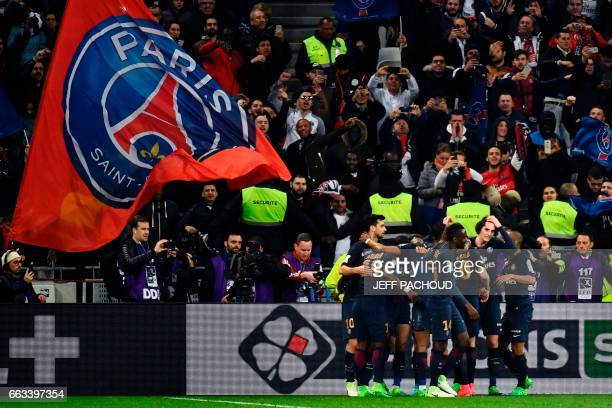 Paris SaintGermain's players celebrate after their Uruguayan forward Edinson Cavani scored his second goal during the French League Cup final...