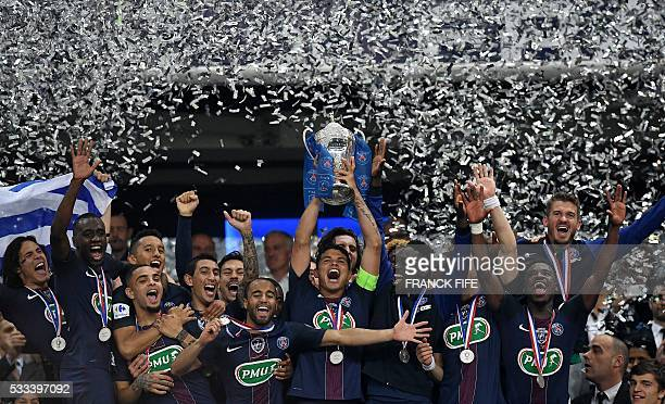 TOPSHOT Paris SaintGermain's players celebrate after winning the French Cup final football match against Marseille on May 21 2016 at the Stade de...