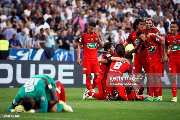 TOPSHOT Paris SaintGermain's players celebrate after winning the French Cup final football match between Paris SaintGermain and Angers on May 27 at...