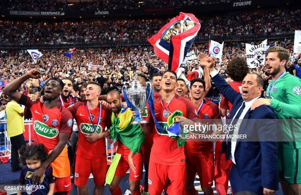 Paris SaintGermain's players celebrate after winning the French Cup final football match between Paris SaintGermain and Angers on May 27 at the Stade...