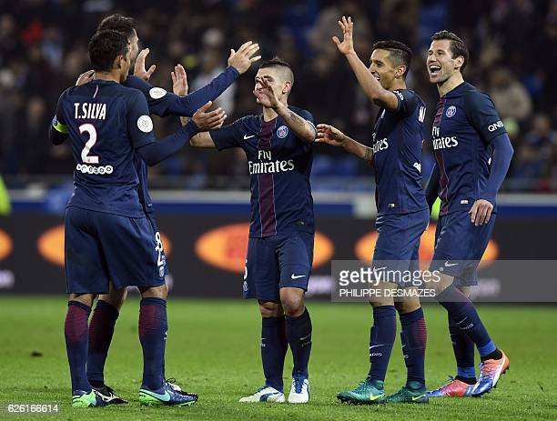 Paris SaintGermain's players celebrate after winning the French L1 football match between Olympique Lyonnais and Paris SaintGermain on November 27 at...
