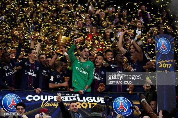 Paris SaintGermain's players celebrate after winning the French League Cup final football match between Paris SaintGermain and Monaco on April 1 at...