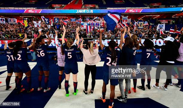 TOPSHOT Paris SaintGermain's players celebrate after winning the UEFA Women's Champions League quarterfinal second leg football match between Paris...