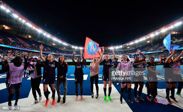 Paris SaintGermain's players celebrate after winning the UEFA Women's Champions League quarterfinal second leg football match between Paris...