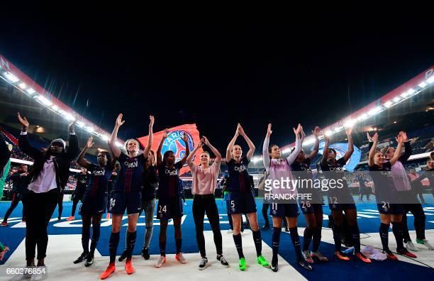 Paris SaintGermain's players celebrate after winning the UEFA Women's Champions League quarterfinal second leg football match between Paris...