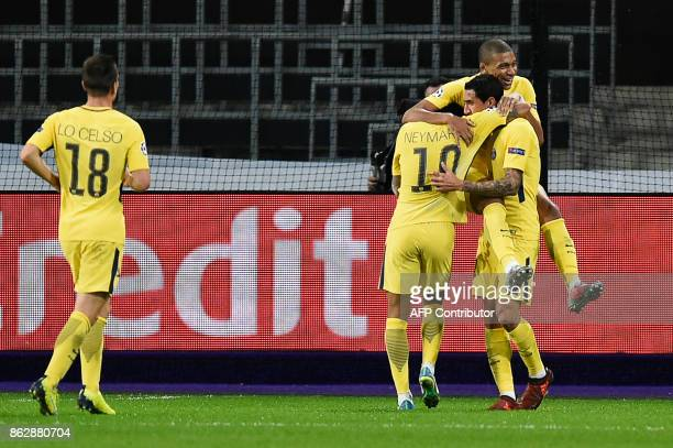 Paris SaintGermain's players celebrate Argentinian forward Angel Di Maria after he scored a goal during the UEFA Champions League Group B football...