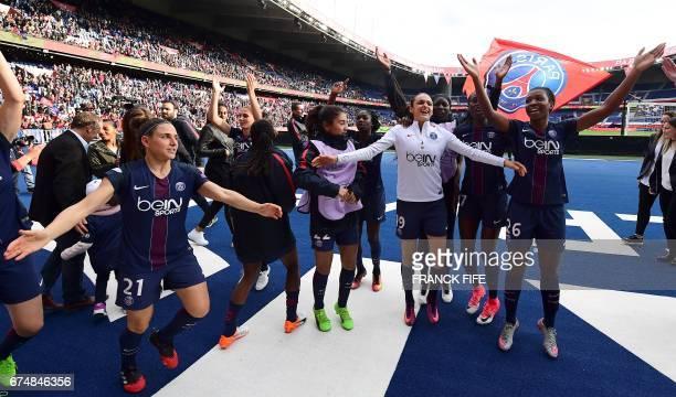 Paris SaintGermain's players celebrate their victory at the end of the UEFA Women's Champions League semifinal second leg football match Paris...