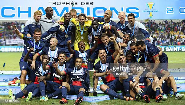 Paris SaintGermain's players celebrate with the trophy after winning the French L1 Champions Trophy football match by defeating Bordeaux 21 on August...