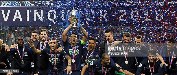 Paris SaintGermain's' players celebrate with the trophy after winning the French Cup final football match beween Marseille and Paris SaintGermain on...