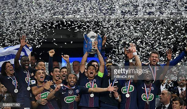 Paris SaintGermain's players celebrate with the trophy after winning the French Cup final football match against Marseille on May 21 2016 at the...