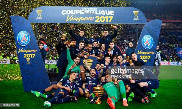 TOPSHOT Paris SaintGermain's players celebrate with the trophy after winning the French League Cup final football match between Paris SaintGermain...