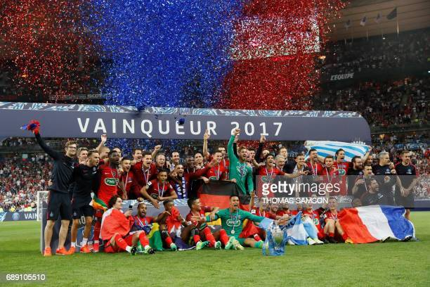 Paris SaintGermain's players celebrate with the trophy after winning the French Cup final football match between Paris SaintGermain and Angers on May...