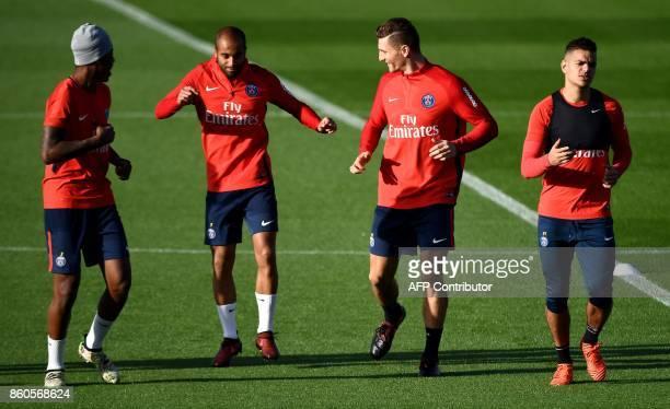 Paris SaintGermain's players French defender Presnel Kimpembe Brazilian midfielder Lucas Moura Belgian defender Thomas Meunier and French forward...