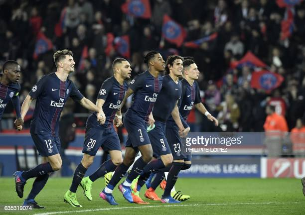 Paris SaintGermain's players French midfielder Blaise Matuidi Belgian defender Thomas Meunier French defender Layvin Kurzawa French defender Presnel...