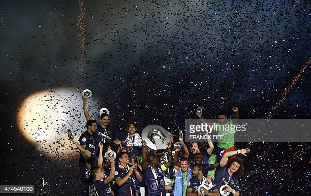Paris SaintGermain's players reacts on the podium after winning the French L1 title at the end of the French L1 football match Paris SaintGermain vs...