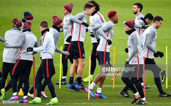 Paris SaintGermain's players run during a training session on January 28 2017 in SaintGermainenLaye west of Paris on the eve of the French L1...