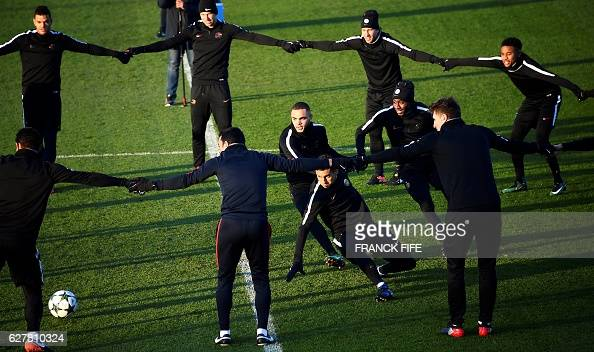 Paris SaintGermain's players take part in a training session on December 5 2016 in SaintGermainenLaye western Paris on the eve of the team's UEFA...