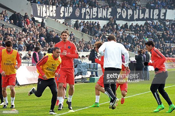 Paris SaintGermain's players warm up prior to the French L1 football match between Bordeaux and Paris SaintGermain on March 15 2015 at the...