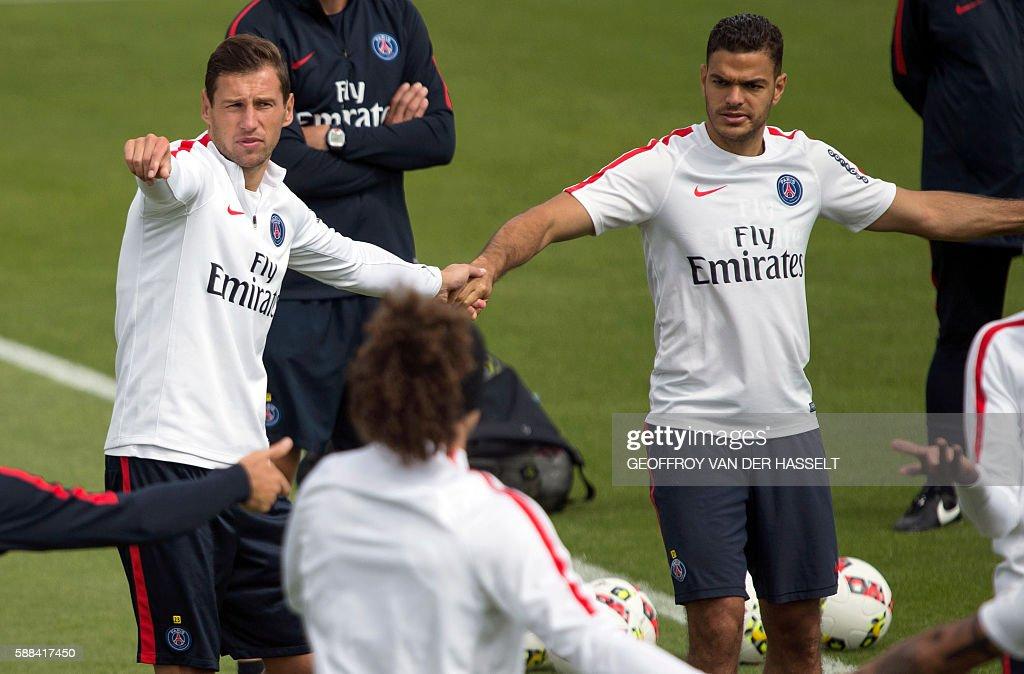 Paris SaintGermain's polish defender Grzegorz Krychowiak and Paris SaintGermain's French forward Hatem Ben Arfa attend a training session at the Camp...