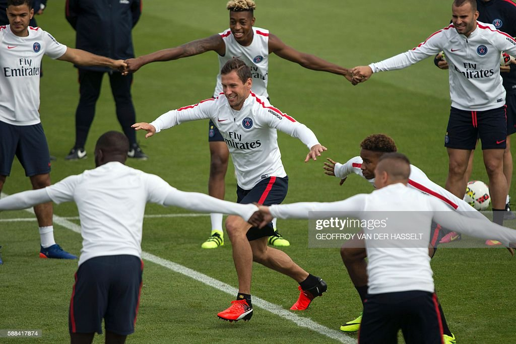 Paris SaintGermain's polish defender Grzegorz Krychowiak and team mates attend a training session at the Camp des Loges training centre in...