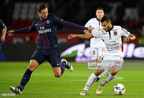 Paris SaintGermain's polish defender Grzegorz Krychowiak vies with Nice's Frenchborn Moroccan midfielder Younes Belhanda during the French L1...
