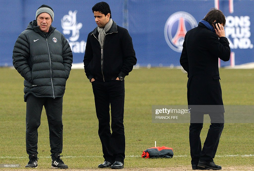 Paris Saint-Germain's Qatari Chairman Nasser Al-Khelaifi (C) speaks with Italian coach Carlo Ancelotti (R) next to Brazilian sporting director Leonardo during a training session on March 5, 2013 at the Parc des Princes stadium in Paris, on the eve of an UEFA Champions League round of 16 second leg football match against Valencia. AFP PHOTO / FRANCK FIFE