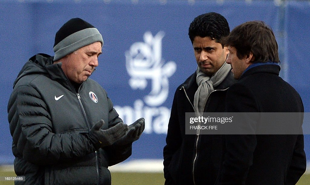 Paris Saint-Germain's Qatari Chairman Nasser Al-Khelaifi (C) speaks with Italian coach Carlo Ancelotti (L) and Brazilian sporting director Leonardo during a training session on March 5, 2013 at the Parc des Princes stadium in Paris, on the eve of an UEFA Champions League round of 16 second leg football match against Valencia.