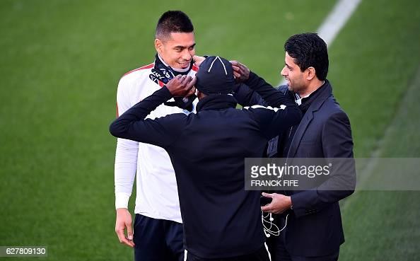 Paris SaintGermain's Qatari president Nasser AlKhelaïfi speaks with Paris SaintGermain's French goalkeeper Alphonse Areola during a training session...