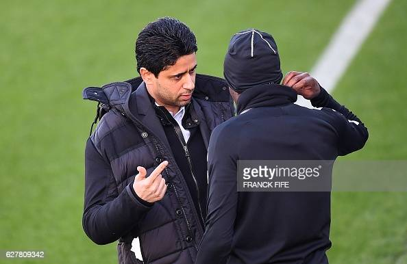 Paris SaintGermain's Qatari president Nasser AlKhelaïfi speaks with Paris SaintGermain's French midfielder Blaise Matuidi during a training session...