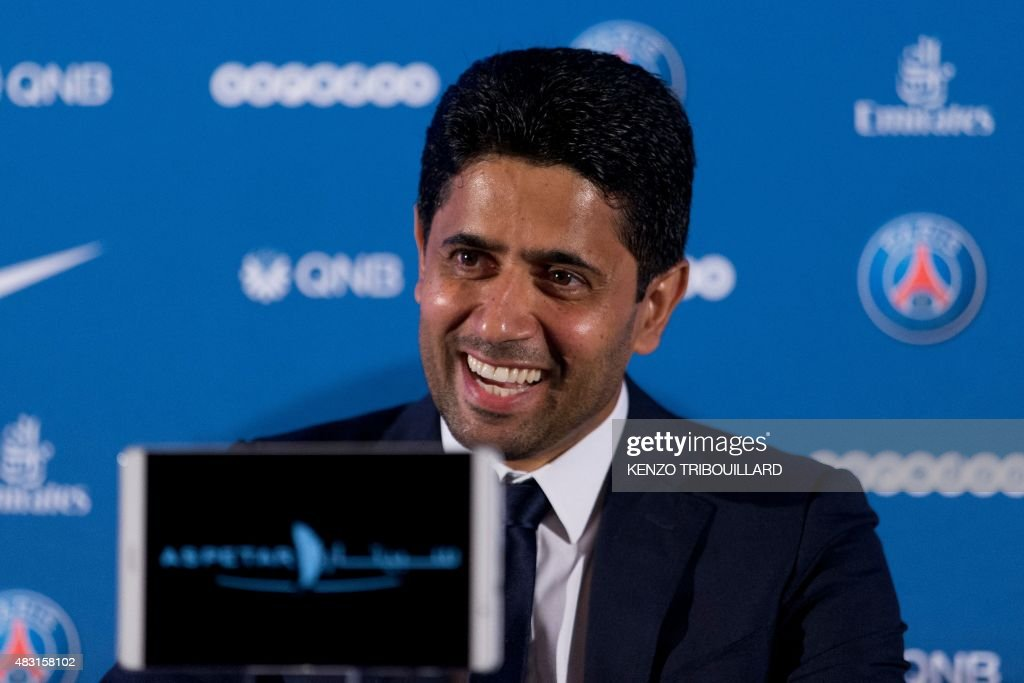 Paris Saint-Germain's Qatari president Nasser Al-Khelaifi smiles as he speaks during a press conference at Shangri-La Hotel in Paris on August 6, 2015. Paris Saint-Germain completed the signing of Di Maria from Manchester United on a four-year deal, the French champions announced. AFP PHOTO / KENZO TRIBOUILLARD