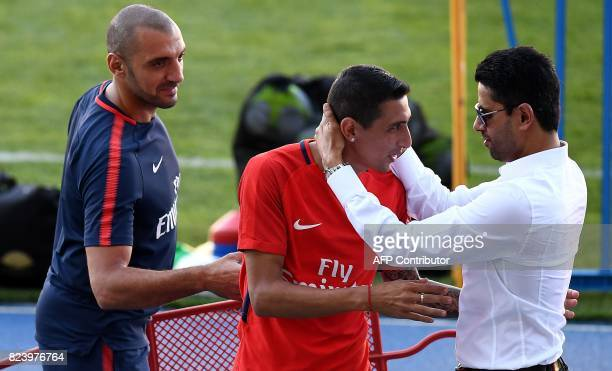 Paris SaintGermain's Qatari president Nasser AlKhelaifi speaks with Paris SaintGermain's Argentinian forward Angel Di Maria at the end of a training...