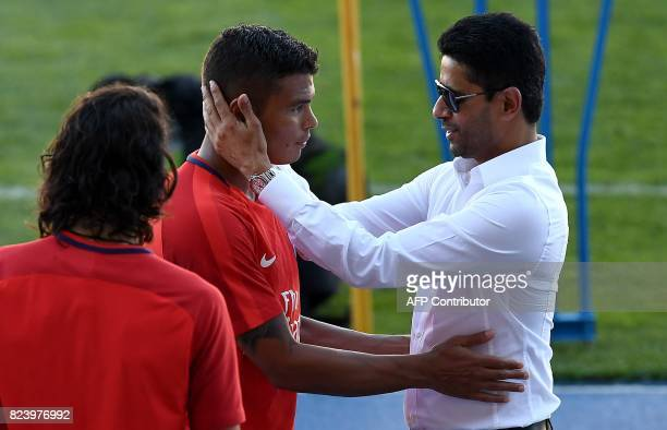 Paris SaintGermain's Qatari president Nasser AlKhelaifi speaks with Paris SaintGermain's Brazilian defender Thiago Silva at the end of a training...