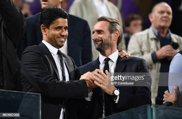 Paris SaintGermain's Qatari president Nasser AlKhelaifi speaks with Paris SaintGermain's assistant general manager JeanClaude Blanc during the UEFA...