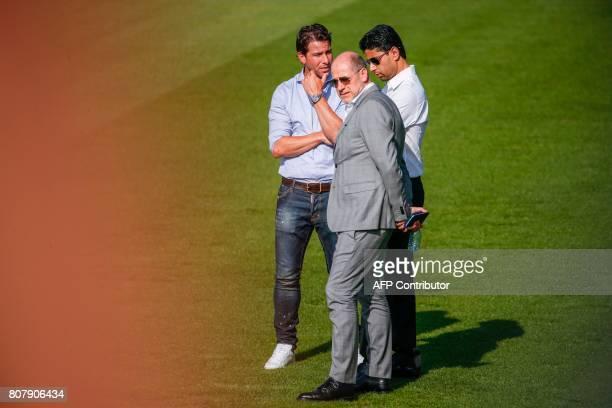 Paris SaintGermain's Qatari president Nasser AlKhelaifi the club's new sports director Portugal's Antero Henrique and PSG's former defender Brazil's...