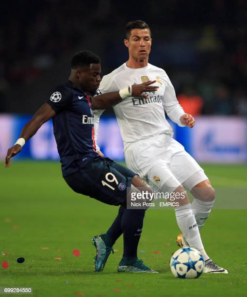 Paris SaintGermain's Serge Aurier and Real Madrid's Cristiano Ronaldo battle for the ball
