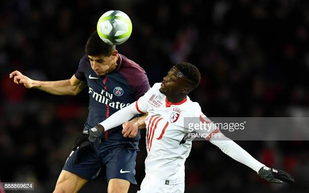 Paris SaintGermain's Spain defender Yuri Berchiche and Lille's Ivorian forward Nicolas Pepe go for a header during the French L1 football match...