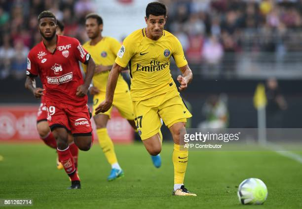 Paris SaintGermain's Spain defender Yuri Berchiche runs with the ball during the French L1 football match between Dijon and Paris SaintGermain at the...