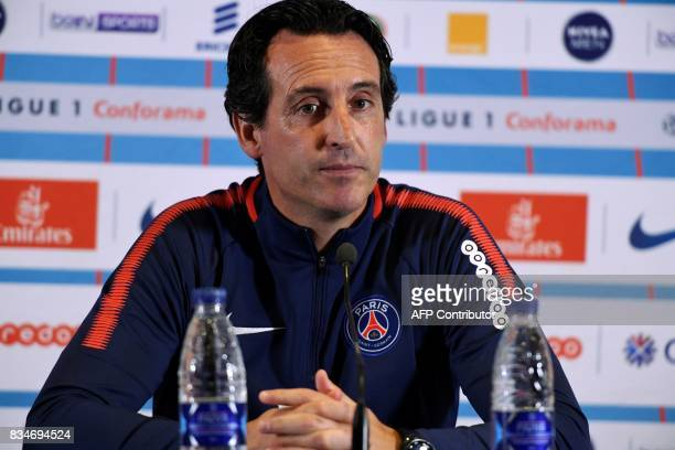 Paris SaintGermain's Spanish coach Unai Emery looks on during a press conference on August 18 2017 at the Camp des Loges in SaintGermainenLaye near...