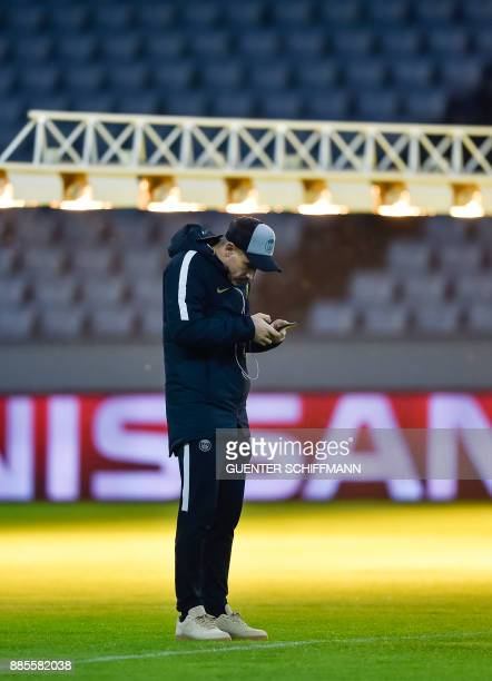 Paris SaintGermain's Spanish defender Yuri Berchiche check his phone on the pitch one day ahead of the UEFA Champions League Group B match between FC...