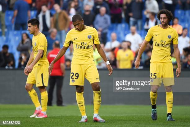Paris SaintGermain's Spanish defender Yuri Berchiche Paris SaintGermain's French forward Kylian Mbappe and Paris SaintGermain's French midfielder...