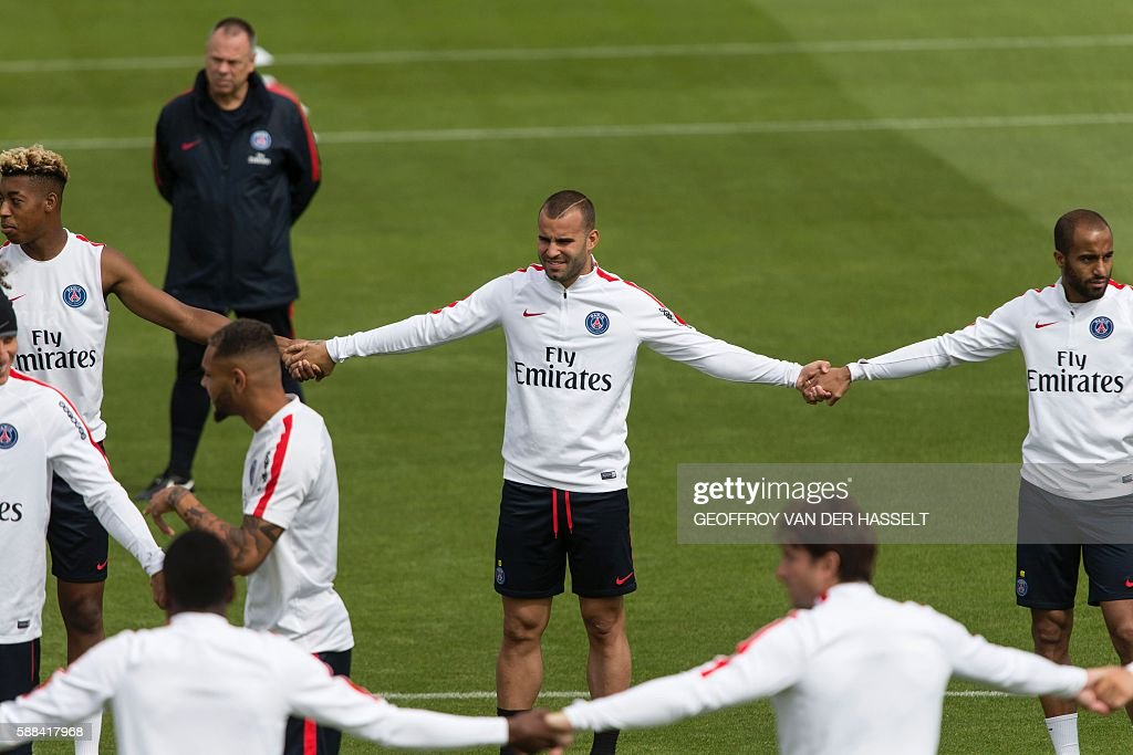 Paris SaintGermain's Spanish forward Jese Rodriguez and team mates attend a training session at the Camp des Loges training centre in...