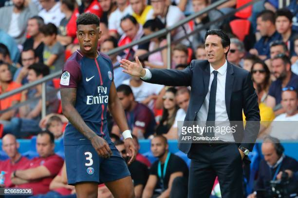 Paris SaintGermain's Spanish head coach Unai Emery gestures next to Paris SaintGermain's French defender Presnel Kimpembe during the French L1...