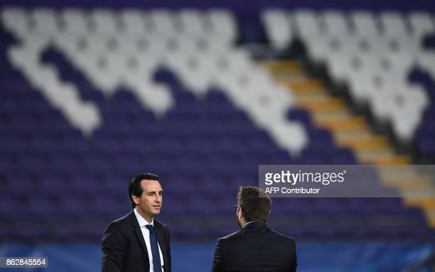 Paris SaintGermain's Spanish head coach Unai Emery stands on the pitch ahead of the UEFA Champions League Group B football match between RSC...