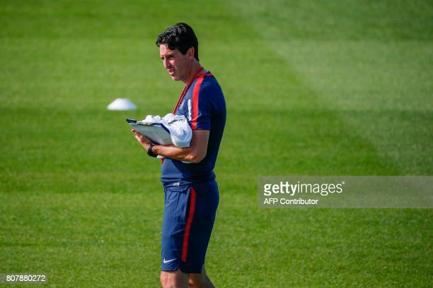 Paris SaintGermain's spanish head coach Unai Emery supervises a training session at the Oredoo training Centre in SaintGermainenLaye on July 4 2017 /...
