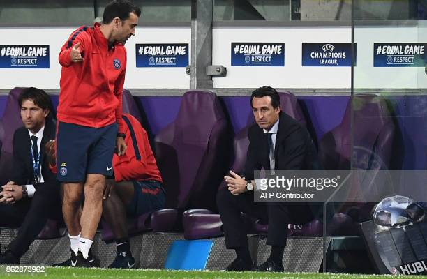Paris SaintGermain's Spanish head coach Unai Emery watches the players during the UEFA Champions League Group B football match between RSC Anderlecht...