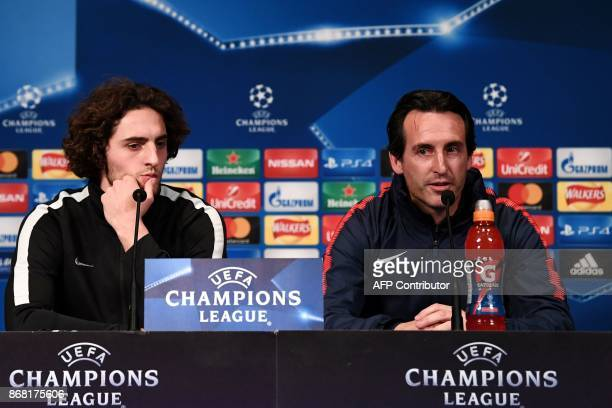 Paris SaintGermain's Spanish headcoach Unai Emery and Paris SaintGermain's French midfielder Adrien Rabiot give a press conference at the Parc des...