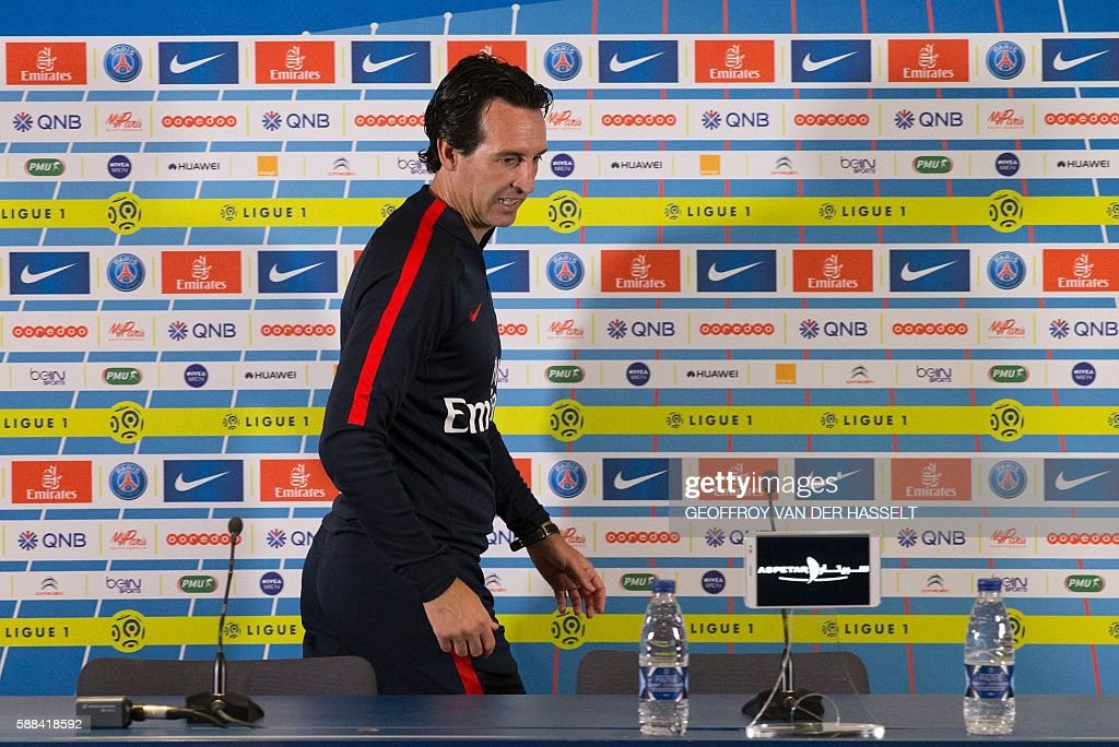 Paris SaintGermain's Spanish headcoach Unai Emery arrives to address a press conference at the Camp des Loges training centre in SaintGermainenLaye...